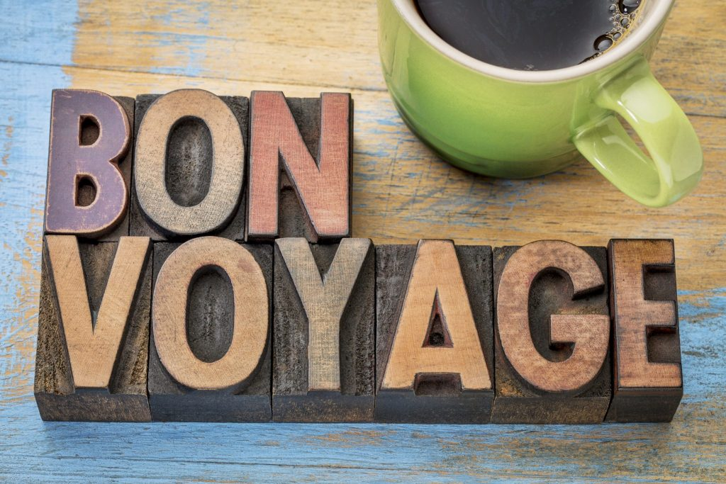 Bon Voyage - travel concept in vintage letterpress wood type blocks stained by color inks