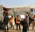 الهلال الأحمر الكويتي يوزع 12400 سلة غذائية وصحية على النازحين العراقيين