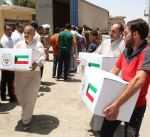 توزيع دفعة جديدة من مساعدات غذائية كويتية لنازحي الأنبار
