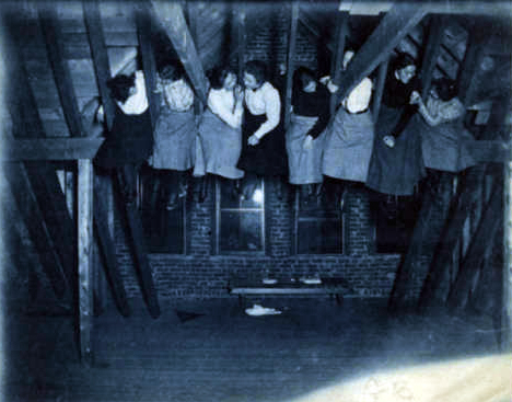 Students eat snacks in the rafters of Pearons, 1901.
