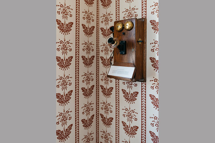 Old telephone in Sycamores mounted on wall