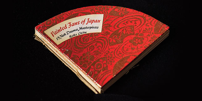 Pie-shaped book with red cover