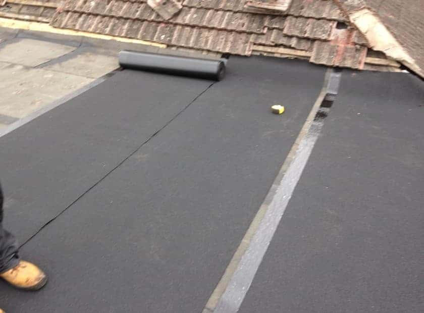 Rolling out Flat Roof Lining