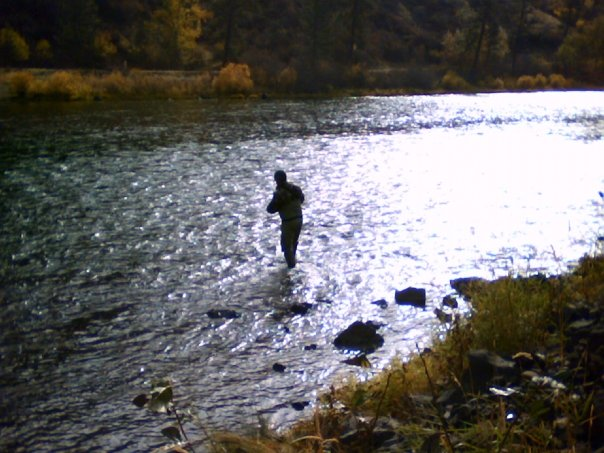 A boy wading a steelhead riffle on the Grande Ronde River
