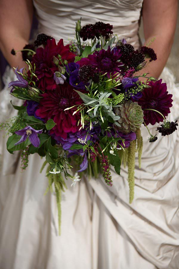 autumnal purple dahlia and succulent bouquet