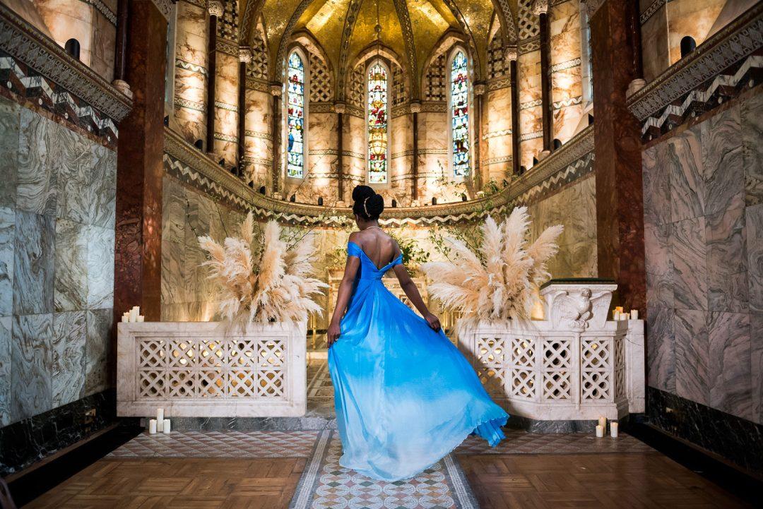 bride on blue ombre wedding dress twirls at altar Fitzrovia Chapel wedding photoshoot but Always Andri Wedding Design