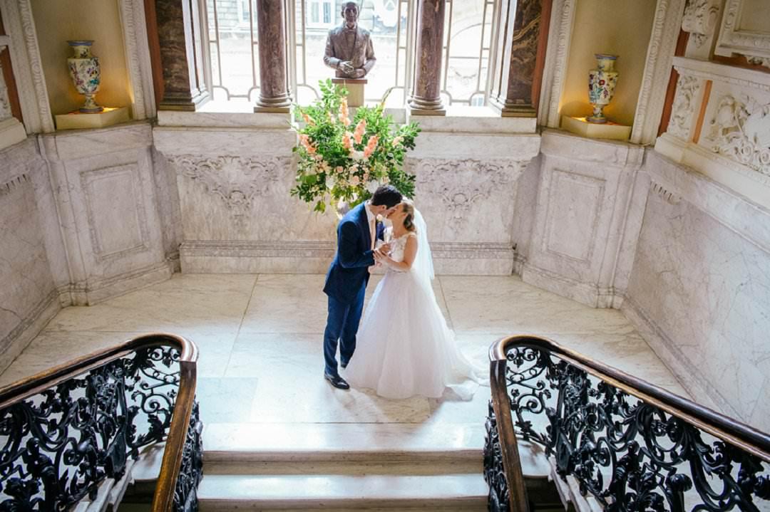 bride and groom kiss Dartmouth House London Wedding Venue