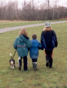 A picture of the children walking the dog