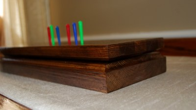 Side view of Cribbage Board with pegs.