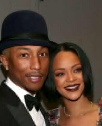 "Pharrell Williams Says Rihanna ""Is From A Different World"" On New Album"