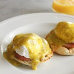 This recipe puts a fun spin on classic hollandaise! Pesto gives the sauce an added kick of flavor and makes for the most delicious eggs Benedict ever!