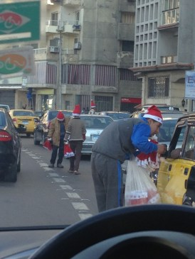Apparently, selling Santa hats in traffic is the newest trend in Egypt.