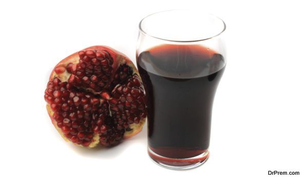 fresh pomegranate juice on a white background