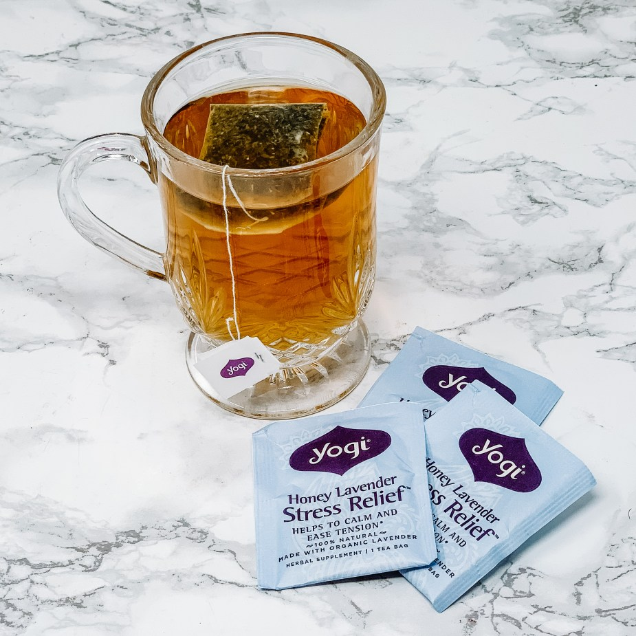 5 Simple Steps For An At Home Spa Night -Yogi Tea - Honey Lavender Stress Relieve in a glass mug.