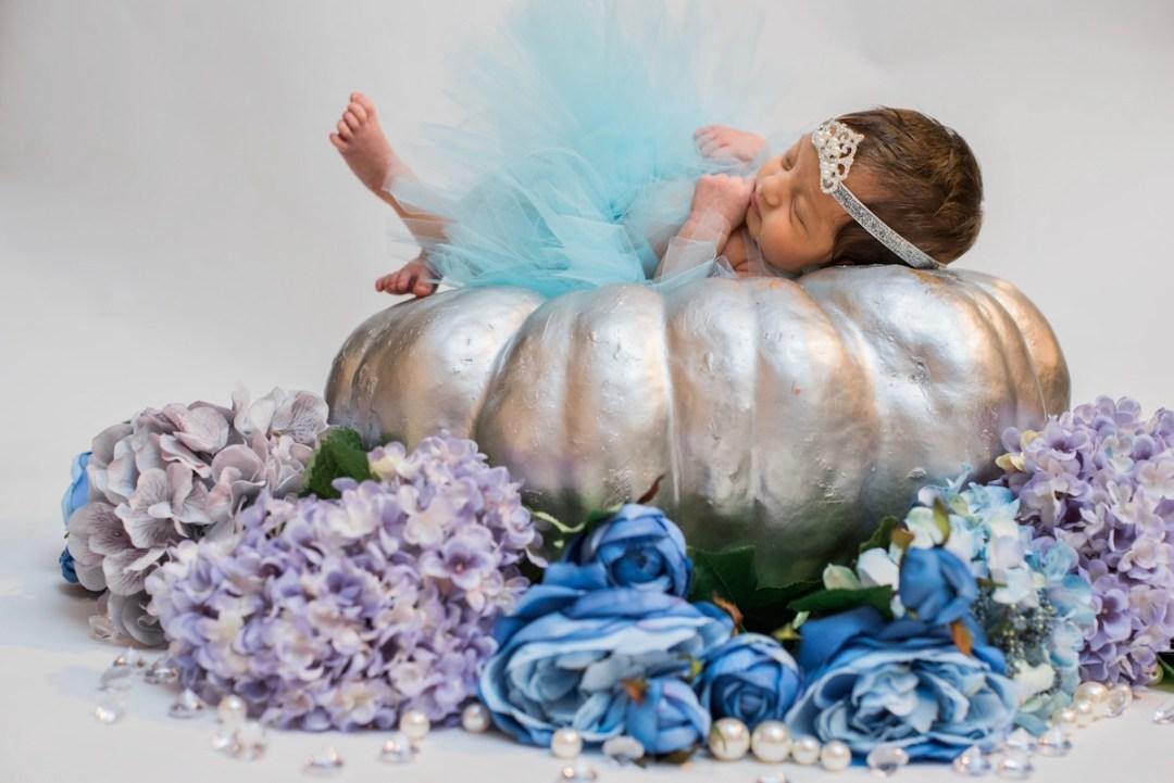 Taleen as Cinderella on a silver pumpkin