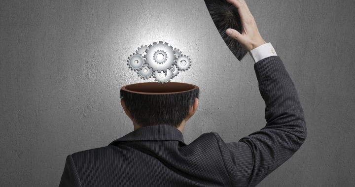 Myers-Briggs Basics: MBTI and INTJ, working metal gears inside businessman head