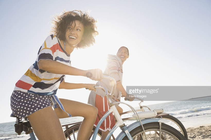 Man and woman riding bicycles. Photo Credit: Hero Images - 468775815. gettyimages.com