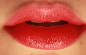 red painted lips with lip fillers