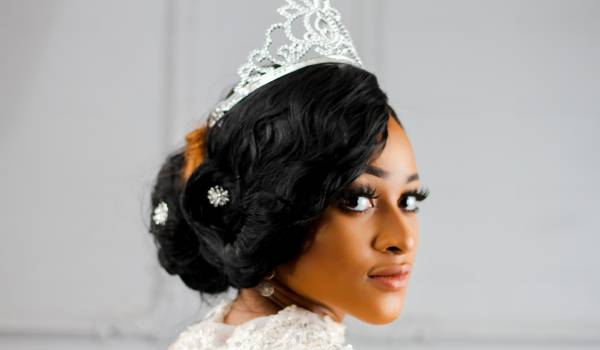 beautiful young black woman with pouted face in silver crown dressed as a queen