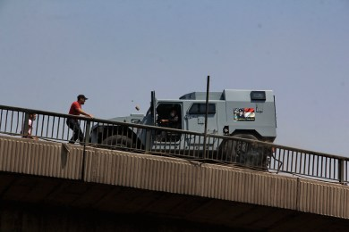 Pro-Morsi throwing stones at a police vehicle on October bridge while the driver reverse rapidly