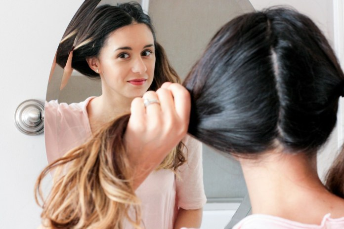 Divide-Sections-of-Your-Hair How to Create the Perfect 'Blow Out' with a Hair Dryer