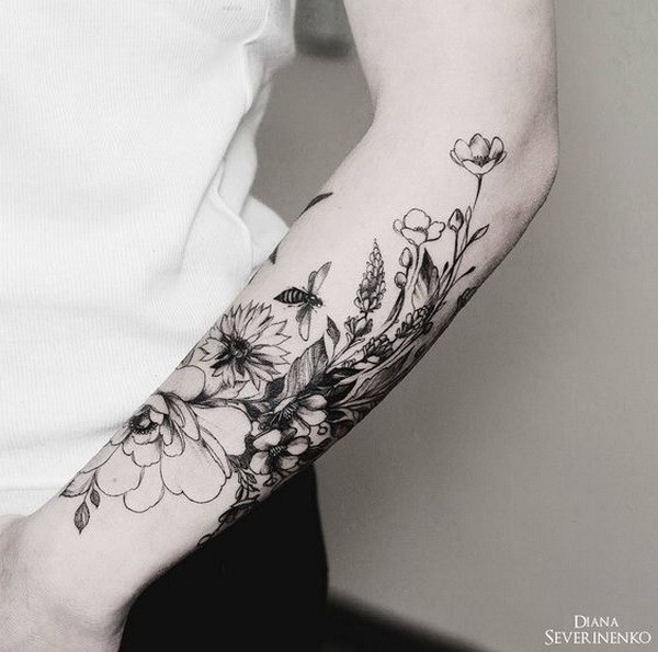 Vintage-Floral-Tattoo-On-Half-Arm Pretty Flower Tattoo Ideas