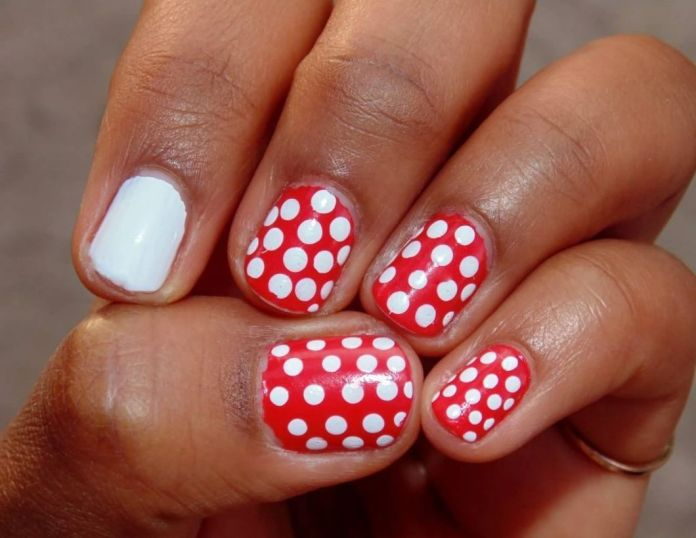 Red-and-white-polka-dots-can-produce-a-superb-design.-Paint-all-your-nails-with-red-and-white-polka-dots-except-one-nail.-Keep-the-accent-nail-blank-and-white-to-have-this-design.-1 2020 Fantastic Nail Design Ideas with Simple Accents