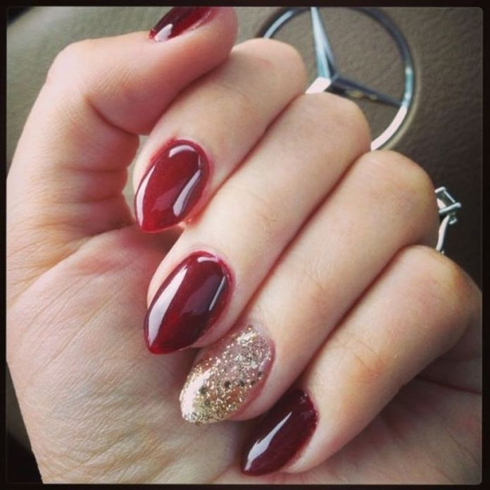 This-deep-red-looks-stunning-on-any-nail.-You-can-have-this-color-painted-on-your-nails.-Then-use-golden-glitters-on-the-blank-nail-to-accentuate-the-accent-nail.-1 2020 Fantastic Nail Design Ideas with Simple Accents
