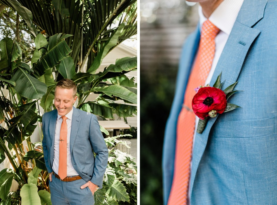 Groom in a blue suit with orange tie and lining