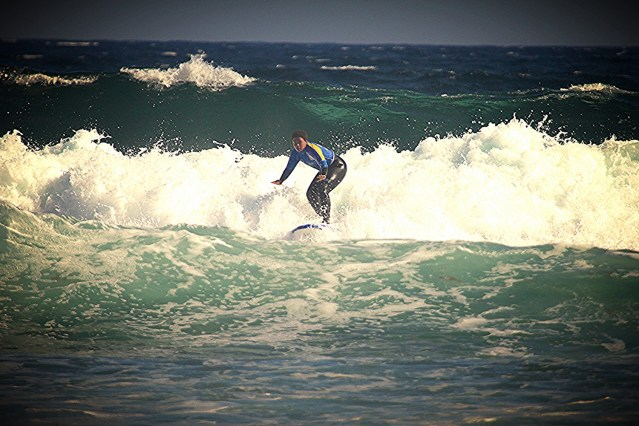 surfing in fuerteventura, surfing, surf trip, girl surfing, la caleta surf beach, planet surf camps, surf camp fuerteventura, surfing fuerteventura
