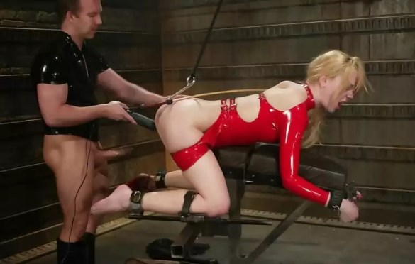 BLONDE BDSM SLAVE IN RED LATEX SUIT FUCKED