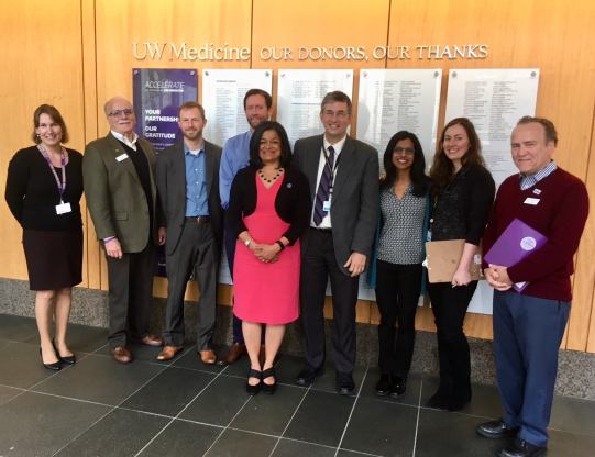 Pramila Jayapal standing with a group of people