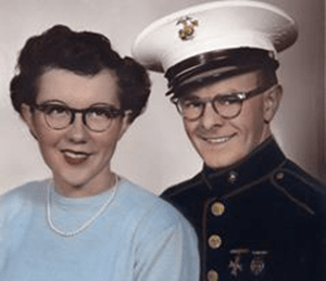 A portrait of a woman and a man in a military uniform