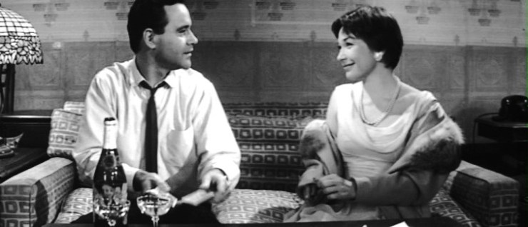Jack Lemmon and Shirley McClain sit together in a still from The Apartment.