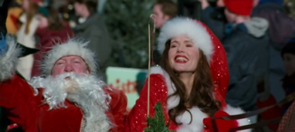 Geena Davis in Long Kiss Goodnight in a Christmas parade.