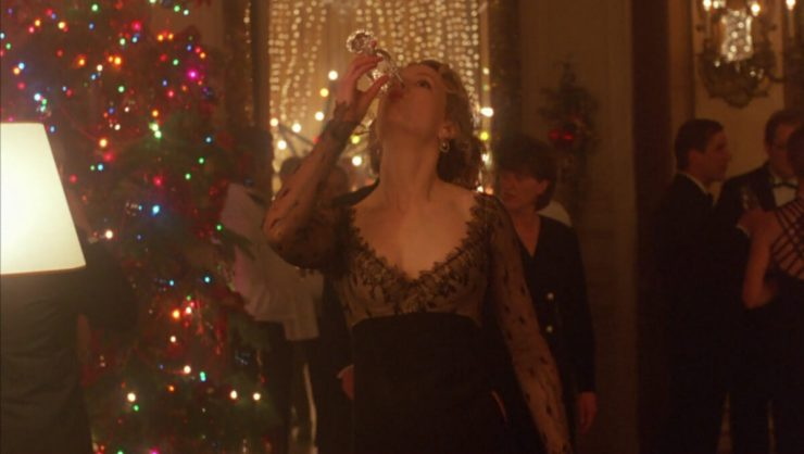 Nicole Kidman drinks champagne at a Christmas party in Eyes Wide Shut