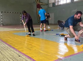 Group in Dilijan giving a fresh coat of paint to the basketball court
