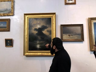 "Father Hamazasp Keshishian facing Ivan Aivazovsky's ""Chaos"" painting"
