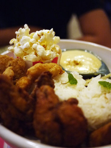 Spicy Beer marinated Chicken Wings & Fish with Butter Popcorn Sauce served with rice with popcorn on the side.