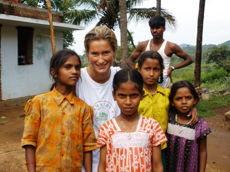 Nelle, AMAIDI Volunteer, with tribal children in Kalvarayan Hills