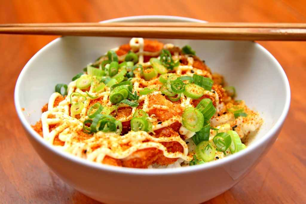 Asian noodles in a white dish with chop sticks resting on the top of the bowl . Instant pot recipes.