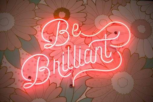 Pink neon lights saying 'be brilliant'