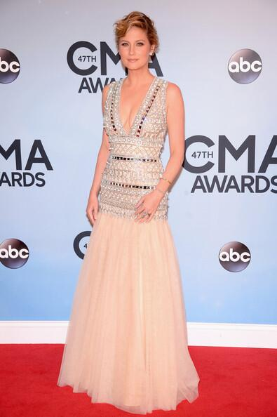 Jennifer Nettles. I'm seeing a trend. Refer to Carrie Underwood & Kacey Musgraves - I think that all of these dresses should have just stopped mid thigh.
