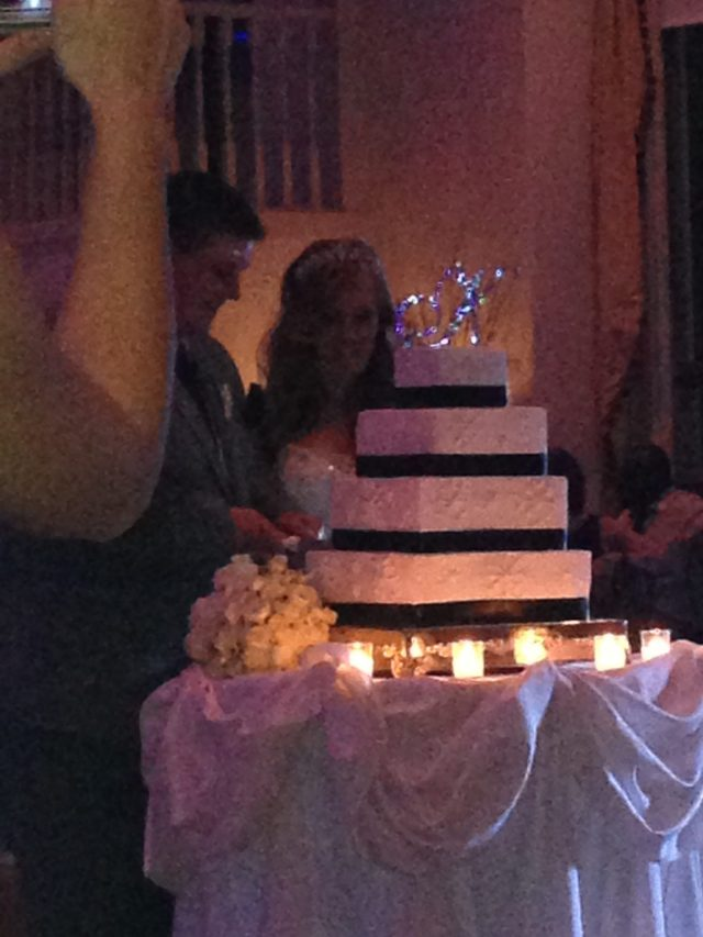 Cake time! Her 4 - tiered cake was gorgeous ( and delicious!)