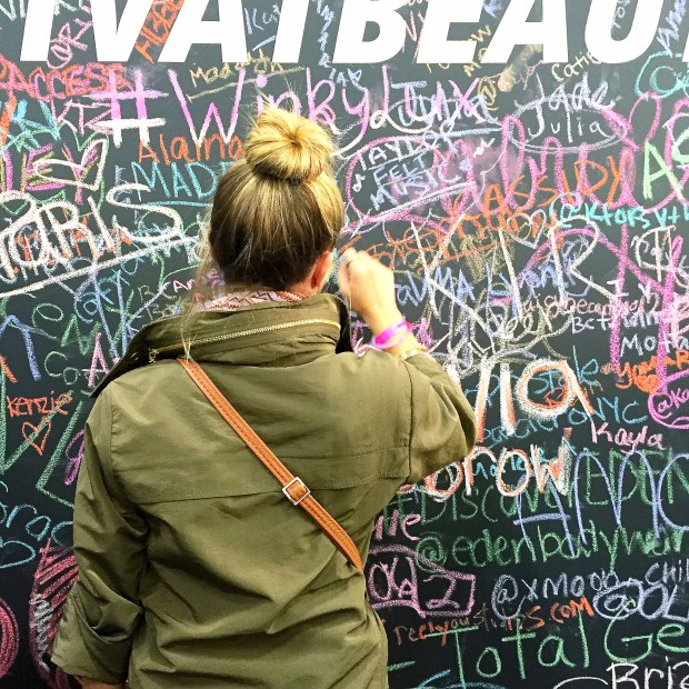 Kath writing on the Awesomeness TV wall