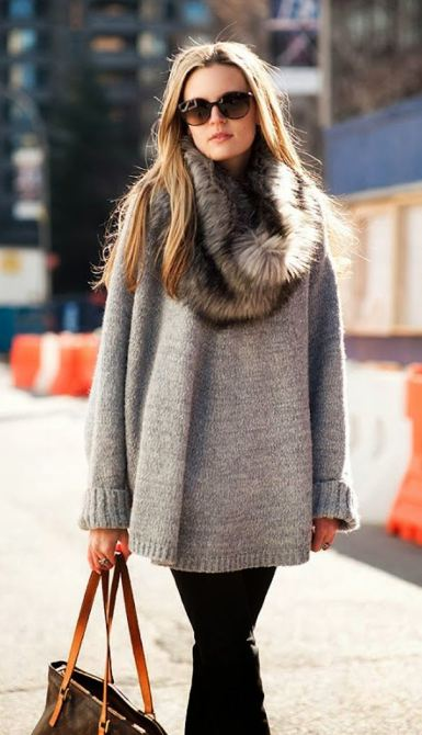 Think chunky sweaters, loose blanket scarves, ponchos, and capes! Source.