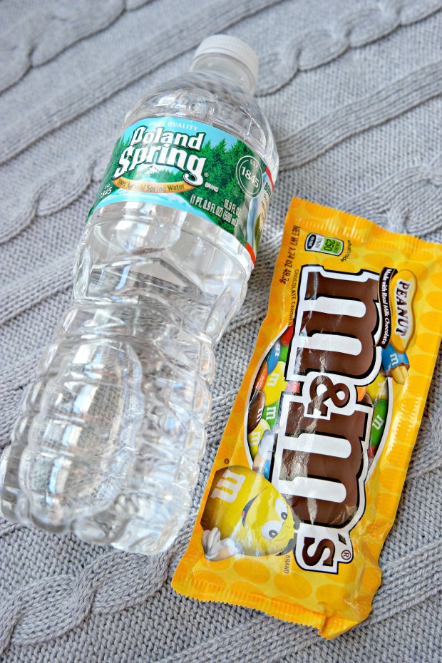I often forget to drink enough while traveling, so a water bottle is crucial! Peanut M+M's are my favorite snacks!