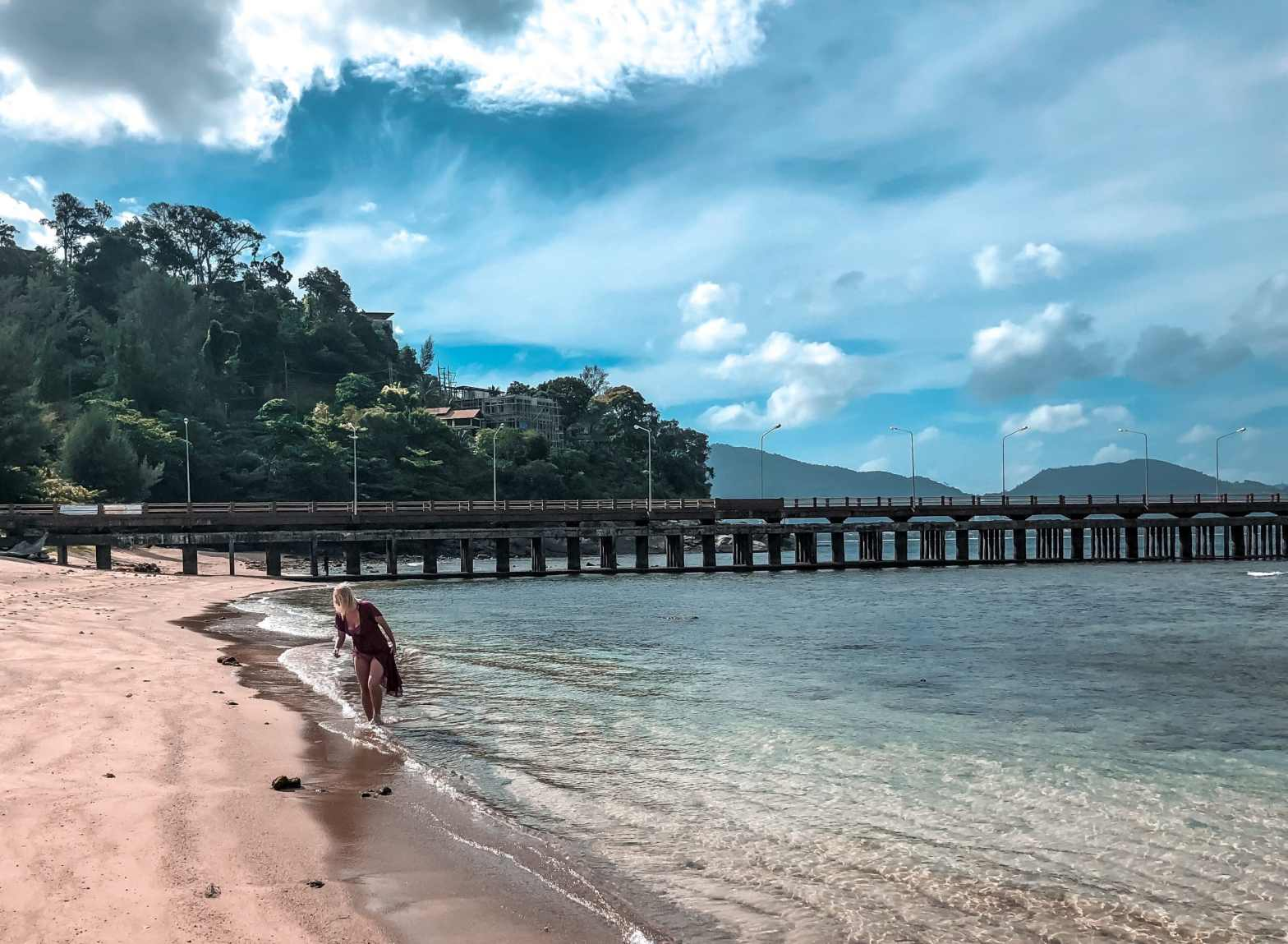 Woman walking in beach in Phuket, Thailand