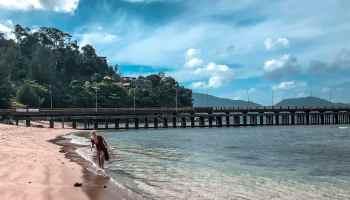 Woman walking in beach in Phuket, Thailand