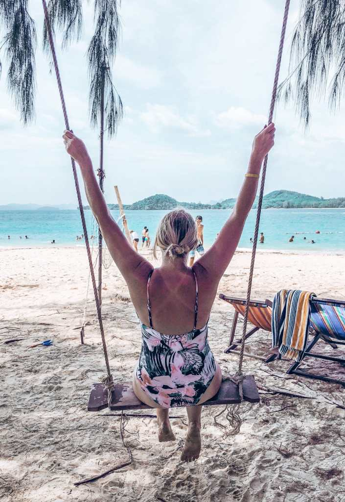Woman sitting on a swing at Bamboo Island